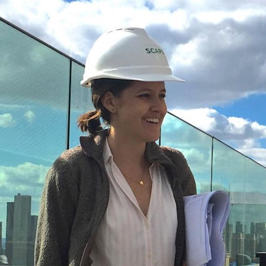 Kate Hayes enjoys views of the Empire State Building while observing construction on the roof terrace of the American Copper Building. Photo credit: Juan Guzman
