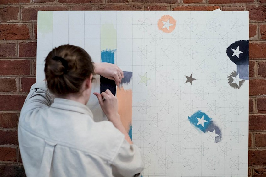 Though Iliescu allowed painters a lot of freedom, she did request that they loosely stick to the stars and stripes pattern drawn by her students. (Photo by Sanjay Suchak, University Communications)